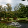 A view of green with water fountain in foreground at Tennanah Lake Golf & Tennis Club