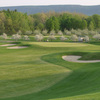 A spring view of green protected by bunkers at Orchard Creek Golf Club