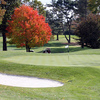 A fall view of a green protected by sand trap at Elmwood Country Club