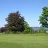 A view of a hole with water in background at Sodus Bay Heights Golf Club