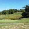 A view of a green with water coming into play at Burden Lake Country Club