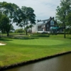 A view over the water with the clubhouse in the distance at Inwood Country Club