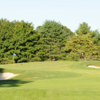 A view of a green protected by sand traps at Mill River Club