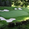 A view of a green protected by bunkers at Lockport Town & Country Club