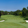 A view of a green flanked by sand traps at Country Club of Rochester