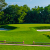 A view of a green protected by bunkers at Sands Point Golf Club