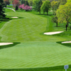 A view of a green and a fairway at Tam O'Shanter Golf Club