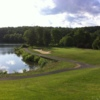 View of a green and lake at Sprain Lake Golf Course