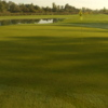 A view  a green with water coming into play at Butternut Creek Golf Course