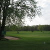A view of a green protected by a bunker at Cold Springs Golf Course