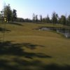 A view of a green with water coming into play at Tamarack Golf Club