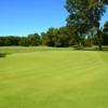 A sunny day view of a hole at North Shore Country Club