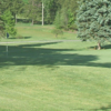 A sunny day view of a green at Grossinger Country Club