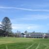 A spring day view of a fairway and the clubhouse at Edison Club