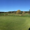 A sunny day view of a hole at Stone Creek Golf Club