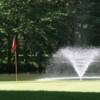 A view of a hole and a water fountain in background at Pinehaven Country Club