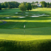 A sunny day view of a green at Fenway Golf Club